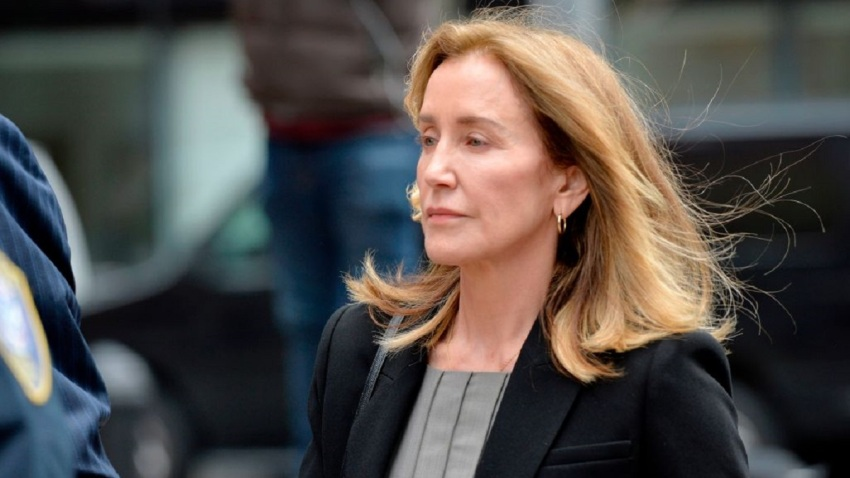 Felicity Huffman escorted by police into court