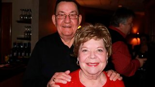 In this 2011 family photo provided by Dawn Bouska, Charles Recka and his wife, Patricia Recka, pose for a photo at a banquet in Naperville, Ill. Charles Recka died on March 12, 2020.