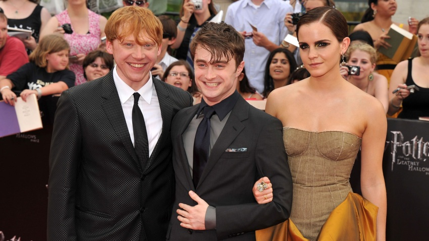 """Rupert Grint, Daniel Radcliffe and Emma Watson attend the New York premiere of """"Harry Potter And The Deathly Hallows: Part 2"""" at Avery Fisher Hall, Lincoln Center on July 11, 2011 in New York City."""