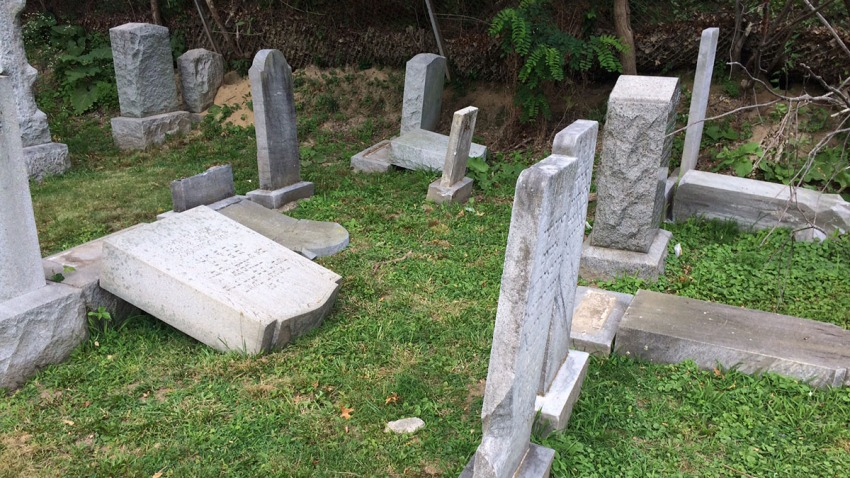 headstones toppled at Ateres Knesseth Israel Cemetery