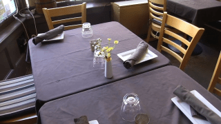 A table set for indoor dining at a Portland, Maine, restaurant