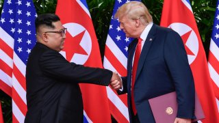 In this June 12, 2018, file photo, North Korea leader Kim Jong Un, left, and U.S. President Donald Trump shake hands at the conclusion of their meetings at the Capella resort on Sentosa Island in Singapore.