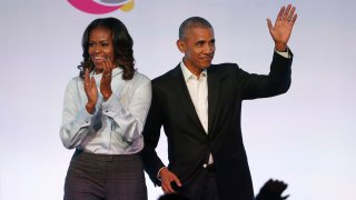 In this Oct. 13, 2017 file photo, former President Barack Obama, right, and former first lady Michelle Obama arrive for the first session of the Obama Foundation Summit in Chicago.