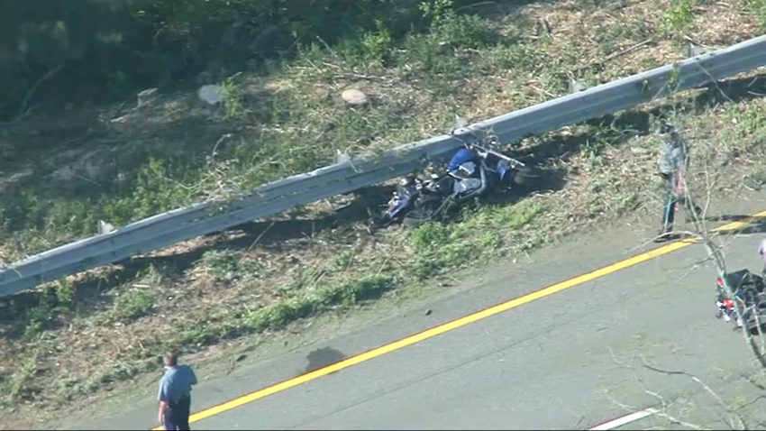 A wrecked motorcycle on I-495 in Salisbury, Massachusetts, after a crash.