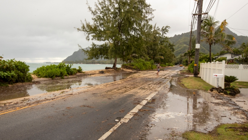 "Sand and debris is left on Kamehameha Highway from high surf generated by Hurricane Douglas, Sunday, July 26, 2020, in Hauula, Hawaii. Hurricane Douglas came within ""razor thin"" distance of the Hawaiian Islands but spared the state the worst of the strong winds, storm surge and flooding officials had warned about."