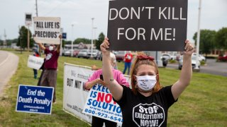 In this July 15, 2020, file photo, protesters against the death penalty gather in Terre Haute, Ind.