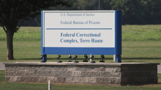 In this July 25, 2019, file photo, a sign marks the entrance to the Federal Correctional Complex Terre Haute in Terre Haute, Indiana.