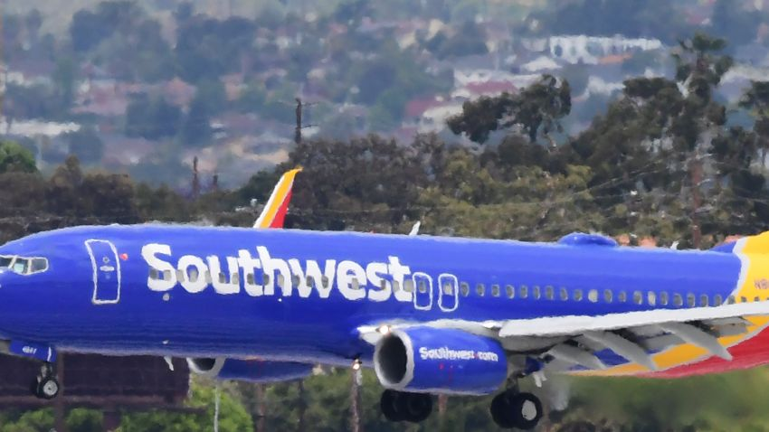 A Southwest Airlines airplane comes in for a landing at Los Angeles International Airport on May 12, 2020 in Los Angeles, California. - The airline and travel industries have been devasted by the coronavirus pandemic as Stay-at-Home orders in Los Angeles, due to end in mid-May, have been extended to July.