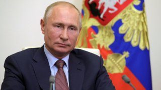 In this file photo dated June 26, 2020, Russian President Vladimir Putin speaks at the Novo-Ogaryovo state residence outside Moscow.