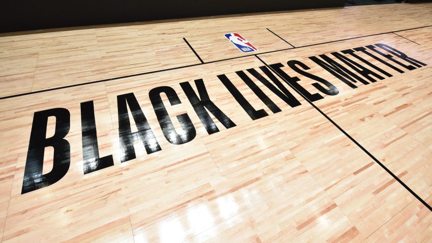 In this July 7, 2020, file photo, a general overall view of the court with Black Lives Matter messaging as part of the NBA Restart 2020 at The Arena at ESPN Wide World of Sports in Orlando, Florida.