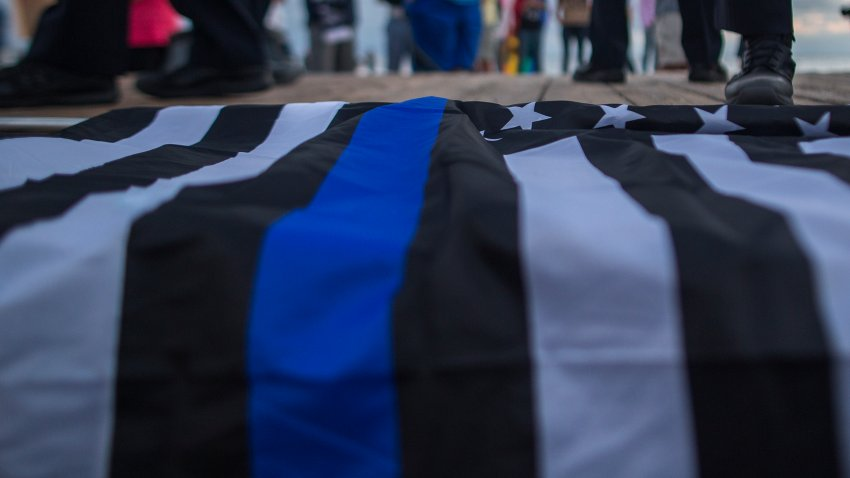 A flag with the thin blue line