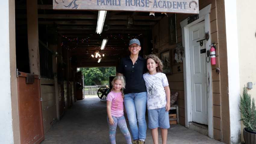"Timea Hunter poses for a photograph with her children Lena, left, and Liam, right, at the Family Horse Academy, where she is hoping to organize education for a group of children during the coronavirus pandemic, Friday, July 31, 2020, in Southwest Ranches, Fla. Confronting the likelihood of more distance learning, families across the country are turning to private tutors and ""learning pods"" to ensure their children receive some in-person instruction. The arrangements raise thorny questions about student safety, quality assurance, and inequality."