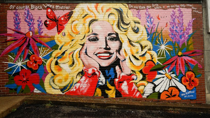 A mural of Dolly Parton is seen outside The 5 Spot, a music club in Nashville, Tenn., Friday, Aug. 21, 2020