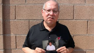 Auska Mitchell holds a photograph of his nephew, Lezmond Mitchell, on Friday, Aug. 21, 2020, in the Phoenix area. Lezmond Mitchell is scheduled to be executed Wednesday, Aug. 26, and the Navajo government is pushing to spare his life on the basis of cultural beliefs and sovereignty.