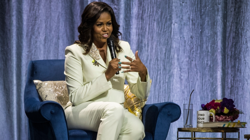 """In this file photo, Michelle Obama speaks during her """"Becoming: An Intimate Conversation with Michelle Obama"""" Tour at the Ericsson Globe Arena on April 10, 2019 in Stockholm, Sweden."""