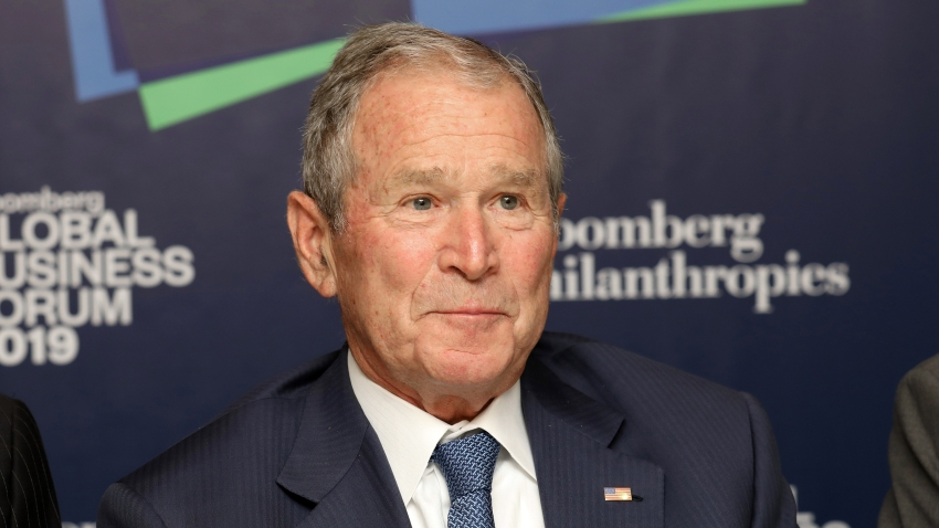 Former U.S. President George W. Bush listens to speaking during the Bloomberg Global Business Forum in New York