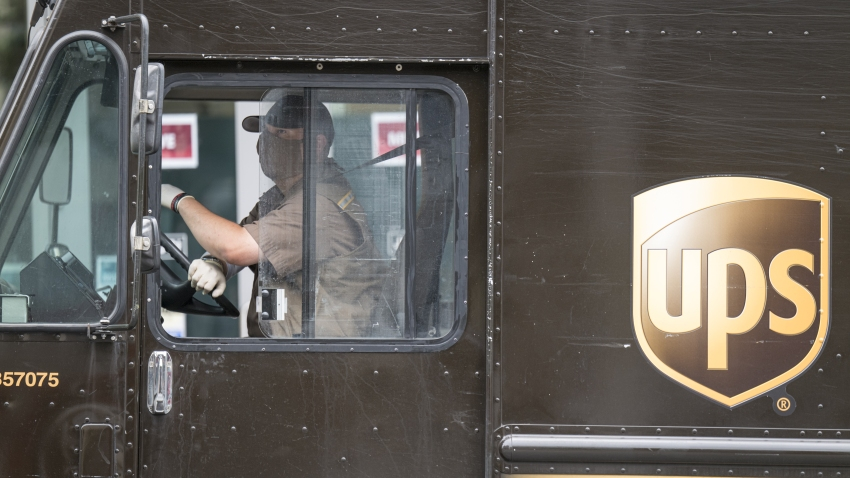 A United Parcel Service (UPS) driver wearing protective mask and gloves makes a delivery in San Francisco, California, U.S., on Monday, May 11, 2020.