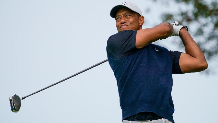 Tiger Woods, of the United States, plays his shot from the ninth tee during the first round of the US Open Golf Championship