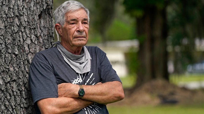 """James Farr stands for a portrait outside his gated community, Good Samaritan Society – Kissimmee Village, Friday, Sept. 25, 2020, in Kissimmee, Fla. While working as a Bible translator in Papua New Guinea in 2016, he voted for Donald Trump by absentee ballot. Now back in the States, he is appalled at how Trump treated the Kurds. """"I really am scared with what Trump does. Feels like he's able to do anything and get away with it."""""""