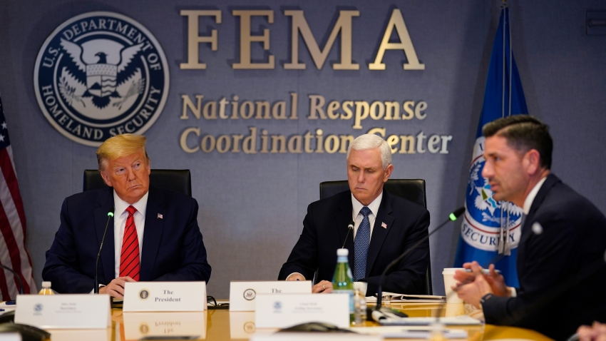 WASHINGTON, DC - MARCH 19: President Donald Trump, left, and Vice President Mike Pence listen as Acting Secretary of Homeland Security Chad Wolf  speaks during a teleconference with governors at the Federal Emergency Management Agency headquarters on March 19, 2020 in Washington, DC. With Americans testing positive from coronavirus rising President Trump is asking Congress for $1 trillion aid package to deal with the COVID-19 pandemic.