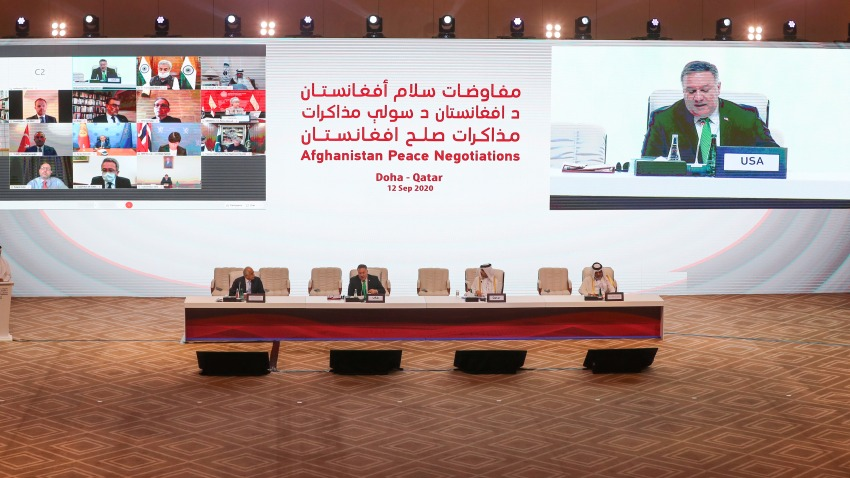 US Secretary of State Mike Pompeo, is broadcasted on the screen, as he delivers a speech during the opening session of the peace talks between the Afghan government and the Taliban in the Qatari capital Doha on September 12, 2020.