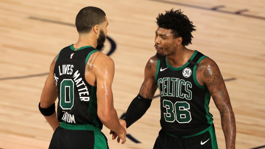 Jayson Tatum #0 of the Boston Celtics and Marcus Smart #36 of the Boston Celtics react to a shot during the fourth quarter against the Toronto Raptors in Game Two of the Eastern Conference Second Round during the 2020 NBA Playoffs at The Field House at ESPN Wide World Of Sports Complex on September 01, 2020 in Lake Buena Vista, Florida.