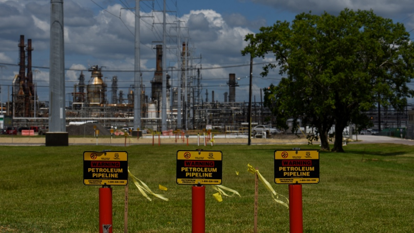 """In this Aug. 24, 2020, file photo, signs read """"Warning Petroleum Pipeline"""" at the Total SE refinery in Port Arthur, Texas."""