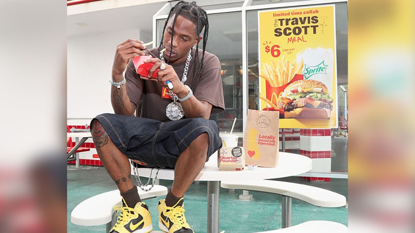 Travis Scott eating fries at McDonald's
