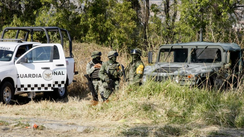 Soldiers stand guard near the site where mass graves were found in Salvatierra, Guanajuato state, Mexico, Thursday, Oct. 29, 2020. A Mexican search group said Wednesday it has found 59 bodies in a series of clandestine burial pits in the north-central state of Guanajuato, and that more could still be excavated.