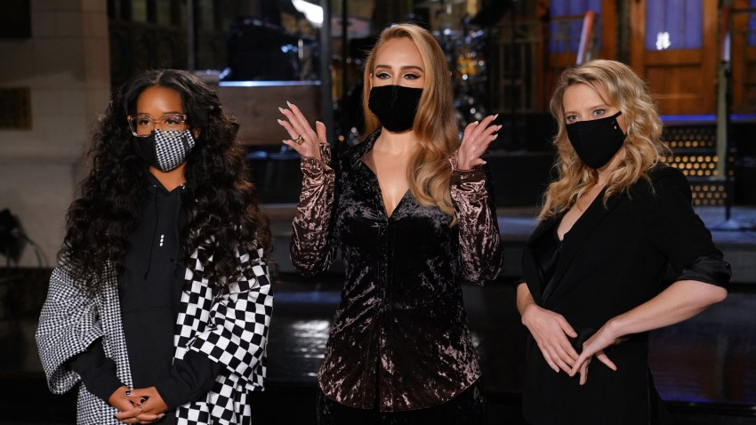 """Musical guest H.E.R, host Adele and Kate McKinnon appear on stage ahead of """"Saturday Night Live."""""""