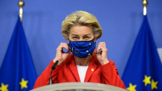 European Commission President Ursula von der Leyen, takes off her protective mask prior to making a statement regarding the Withdrawal Agreement at EU headquarters in Brussels, Thursday, Oct. 1, 2020. The European Union took legal action against Britain on Thursday over its plans to pass legislation that would breach parts of the legally binding divorce agreement the two sides reached late last year.