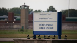 File photo: View of a sign outside the Terre Haute Federal Correctional Complex in Indiana.