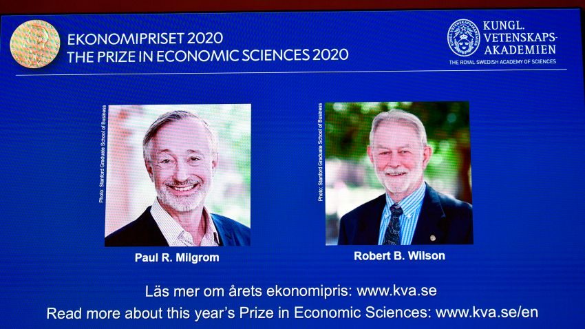 "A screen shows pictures of US economists Paul Milgrom (L) and Robert Wilson during the announcement of the winners of the ""2020 Nobel Prize Sveriges Riksbank Prize in Economic Sciences in Memory of Alfred Nobel"" at the Royal Swedish Academy of Sciences in Stockholm on October 12, 2020."