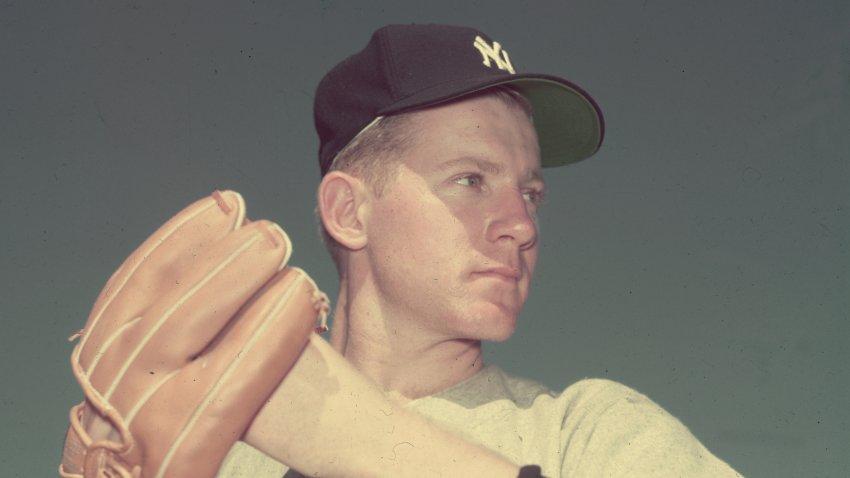 circa 1955: New York Yankees pitcher Whitey Ford wearing a baseball glove while preparing to throw a baseball.
