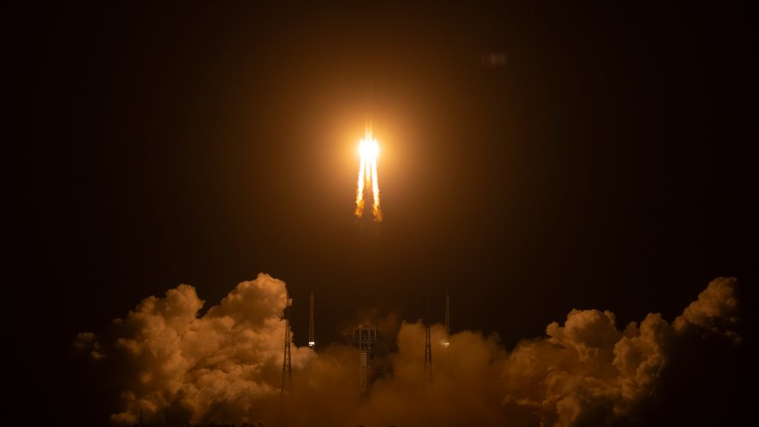 A Long March-5 rocket carrying the Chang'e 5 lunar mission lifts off at the Wenchang Space Launch Center in Wenchang in southern China's Hainan Province, early Tuesday, Nov. 24, 2020. China launched an ambitious mission on Tuesday to bring back material from the moon's surface for the first time in more than 40 years — an undertaking that could boost human understanding of the moon and of the solar system more generally.