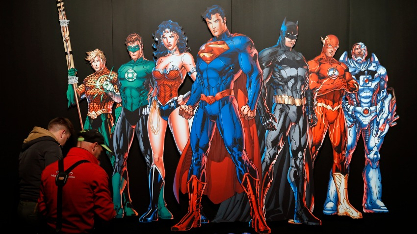 "In this April 26, 2018, file photo, a DC Comics universe poster of Batman, Superman, Wonder Woman, The Joker, The Flash and others is displayed during the press preview of the exhibition ""The Art of the Brick: DC Super Heroes"" at Parc de la Villette in Paris, France."