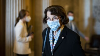 Senator Dianne Feinstein, a Democrat from California, wears a protective mask as she departs following a vote at the U.S. Capitol in Washington, D.C., U.S., on Tuesday, Nov. 17, 2020. President-elect Biden yesterday threw his weight behind House Democrats' proposals for a coronavirus relief bill, calling for aid to state and local governments, among other measures.