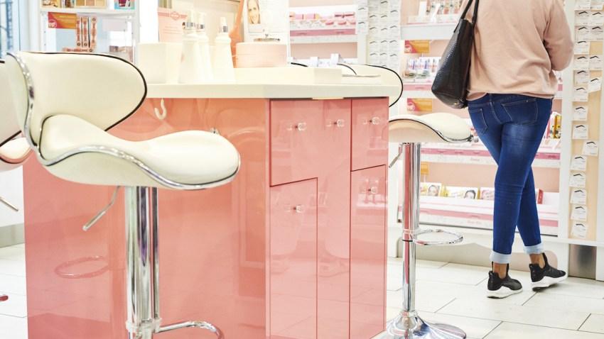 A customer views Benefit Cosmetics makeup on display at an Ulta Beauty Inc