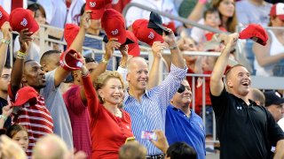 In this July 31, 2012, file photo, then Vice President of the United States Joe Biden waves to the crowd during a military salute in between innings of the game between the Philadelphia Phillies and the Washington Nationals at Nationals Park in Washington, DC.