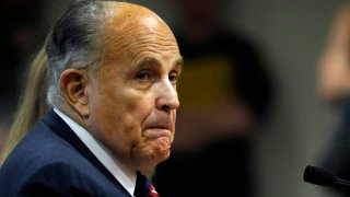 In this Dec. 2, 2020, file photo, Rudy Giuliani, personal lawyer of US President Donald Trump, looks on during an appearance before the Michigan House Oversight Committee in Lansing, Michigan.
