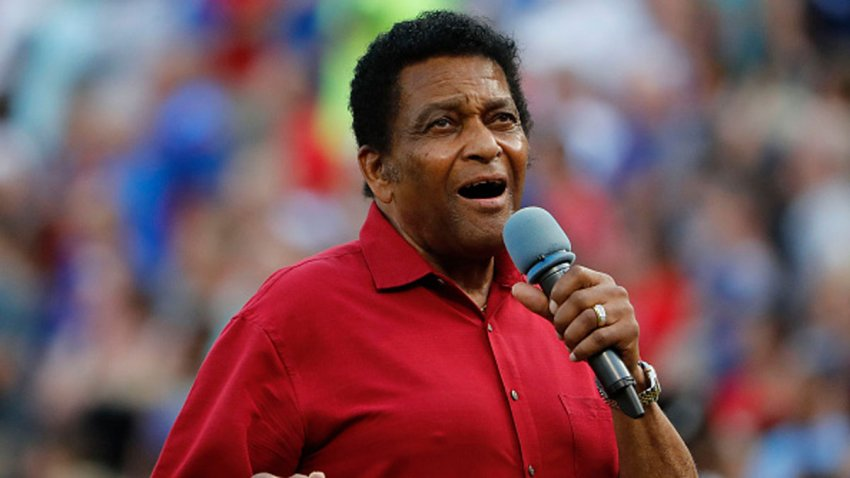 Country Music Hall of Fame member Charley Pride sings the National Anthem before the Cleveland Indians play the Texas Rangers in Arlington, Saturday, July 21, 2018.