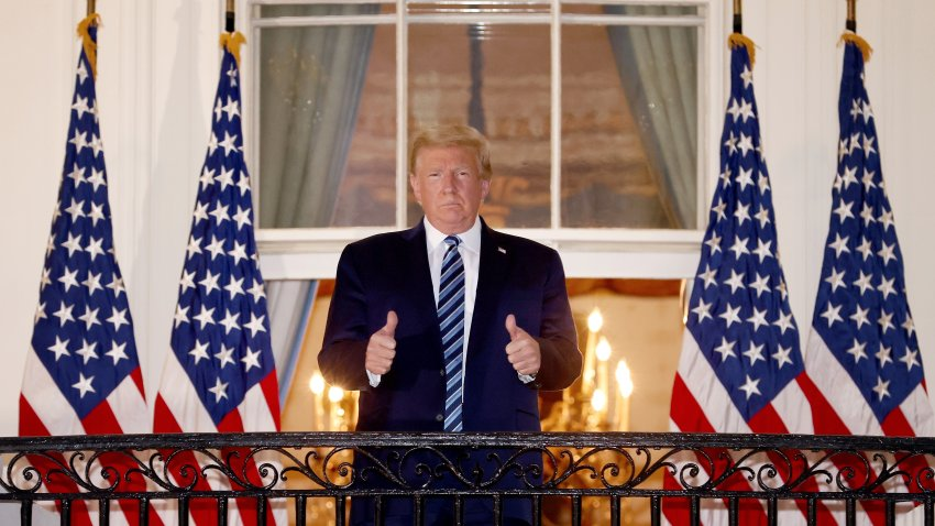 President Donald Trump gives a thumbs up upon returning to the White House from Walter Reed National Military Medical Center on Oct. 5, 2020, in Washington, D.C.