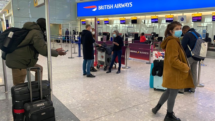 British travelers returning to their homes in Spain wait to speak to airline staff after they were refused entry onto planes, at London's Heathrow airport