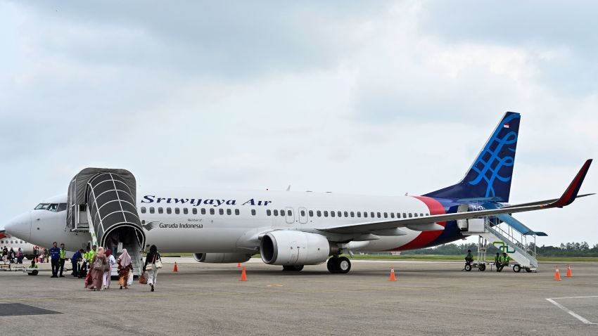 This picture taken on September 3, 2019, shows passengers boarding a Sriwijaya Air Boeing 737-800 aircraft at the airport in Padang, West Sumatra.