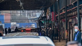 Cars transporting members of the World Health Organization (WHO) team, investigating the origins of the Covid-19 coronavirus, arrive at the closed Huanan Seafood wholesale market in Wuhan, China's central Hubei province on January 31, 2021.