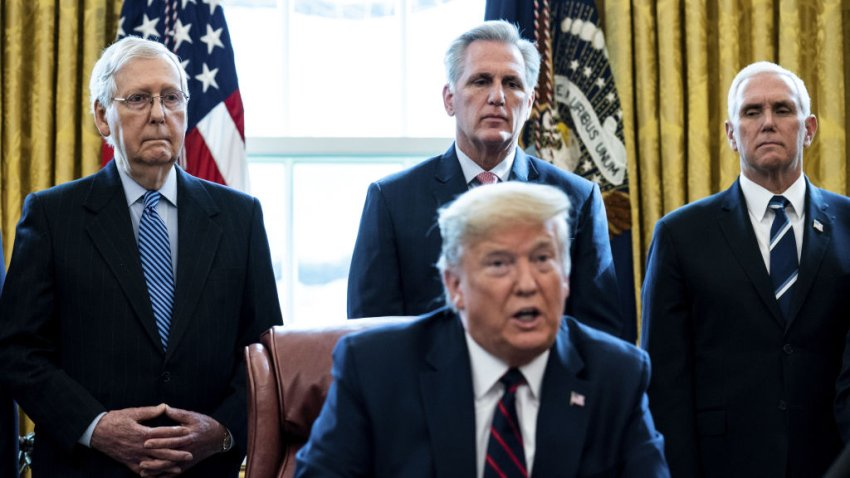 Senate Majority Leader Mitch McConnell, a Republican from Kentucky, from left, U.S. House Minority Leader Kevin McCarthy, a Republican from California, and U.S. Vice President Mike Pence listen as U.S. President Donald Trump speaks before signing the H.R. 748, Coronavirus Aid, Relief, and Economic Security (CARES) Act, in the Oval Office of the White House in Washington, D.C., U.S., on Friday, March 27, 2020.