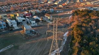 An aerial view from a drone shows electrical lines running through a neighborhood on February 19, 2021 in Austin, Texas