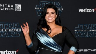 """In this Dec. 16, 2019, file photo, actress Gina Carano attends the premiere of Disney's """"Star Wars: The Rise of Skywalker"""" in Hollywood, California."""