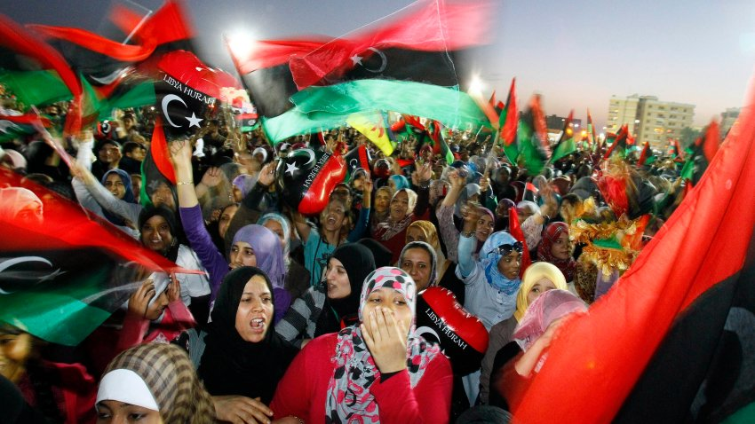 In this Sunday Oct. 23, 2011, file photo, Libyan celebrate at Saha Kish Square in Benghazi, Libya, as Libya's transitional government declares the official liberation of Libya after months of bloodshed that culminated in the death of longtime leader Moammar Gadhafi. Ten years ago, an uprising in Tunisia opened the way for a wave of popular revolts against authoritarian rulers across the Middle East known as the Arab Spring. For a brief window as leaders fell, it seemed the move toward greater democracy was irreversible. Instead, the region saw its most destructive decade of the modern era. Syria, Yemen, Libya and Iraq have been torn apart by wars, displacement and humanitarian crisis.