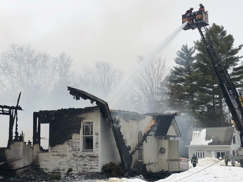 Firefighters douse flames at a Vermont church